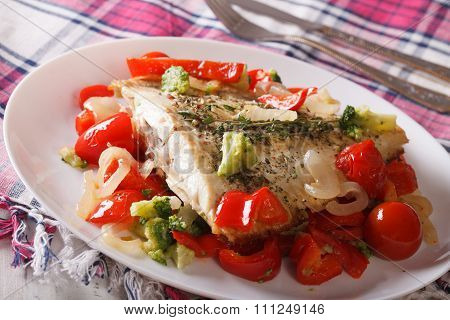 Baked Plaice With Seasonal Vegetables Close-up On A Plate