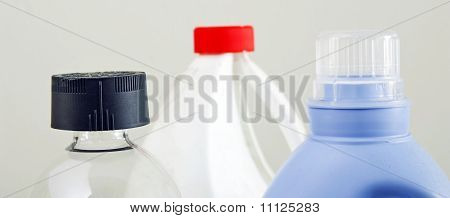 Generic view of the top of bottles of cleaning products poster