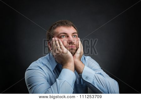 Thoughtful businessman is dreaming about something