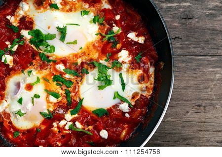 Fresh Eggs Poached In Pan. In Tomato Sauce And Onion, Red, Yellow Pepper