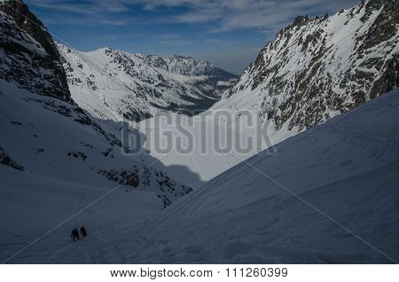 A winter hike is in mountains