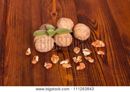 Walnuts with shell and green leaves
