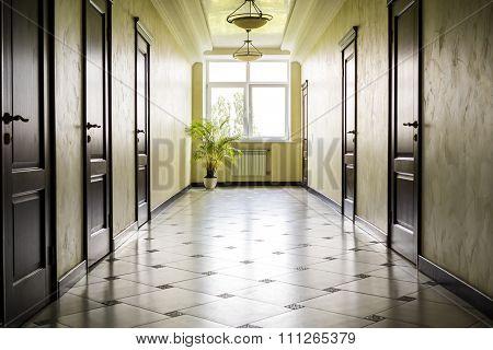 Kiev Ukraine - July 6 2015: White Hallway With Marble Floor, Brown Doors And Window In Hospital