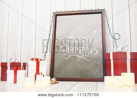 Merry Christmas Inscription On Picture Frame With Red And White Gift Boxes