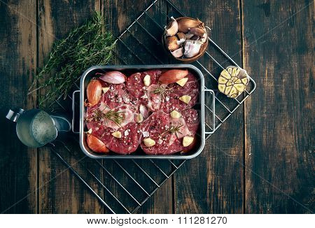 Top View Of Meat In Steel Pan Ready To Cook In Oven