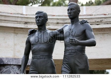 Nettuno - April 06: Bronze Statue Of Two Brothers In Arms Of The American Military Cemetery Of Nettu