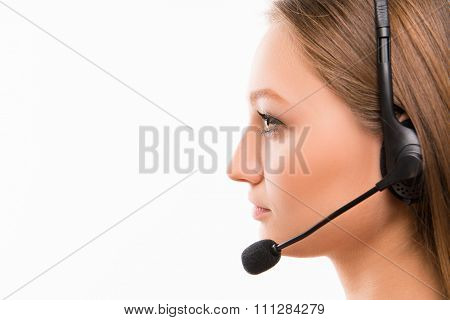 A Close-up Side-face Portrait Of A Young  Agent Of Call Centre