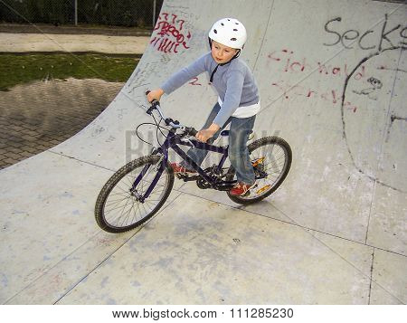 Child With Bike In The Half Pipe