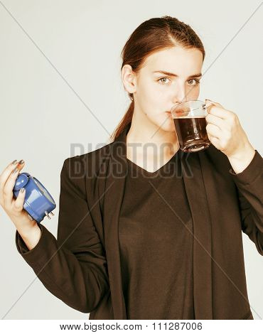 young beauty woman in business style costume waking up for work early morning on white background with clock drinking coffee tired face poster