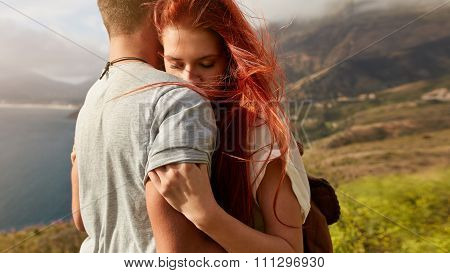 Young Couple In Love Embracing Outdoors