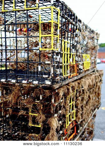 lobster traps sitting on the pier waiting to be set. poster