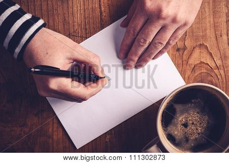 Woman Drinking Coffee And Writing Letters