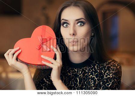 Surprised Beautiful Woman Holding Heart Shape Gift