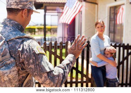 military father waving goodbye to his sad family