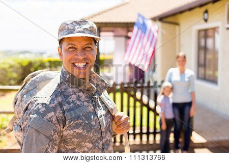 happy soldier returning home with family on background