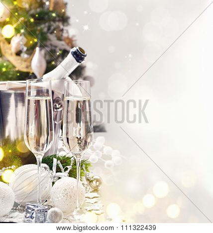 Christmas and New Year celebration with champagne. Holiday dinner table setting with Christmas decoration and sparkling wine. Champagne