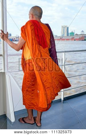 YANGON, MYANMAR - november 24, 2015: Monk on the ferry at Yangon, Myanmar. Buddhism in Myanmar is predominantly of the Theravada tradition, practised by 89% of the country's population.