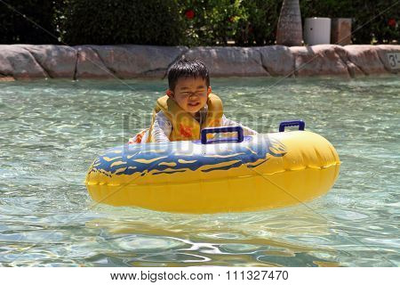 Japanese boy swiming in the pool (2 years old)