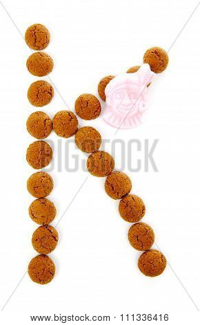 Ginger Nuts, Pepernoten, In The Shape Of Letter K Isolated On White Background