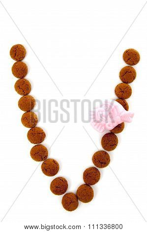 Ginger Nuts, Pepernoten, In The Shape Of Letter V Isolated On White Background