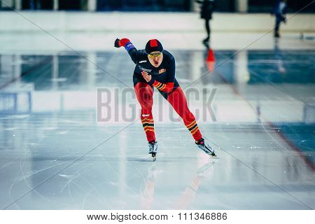 front view of woman athlete speedskater running sprint track