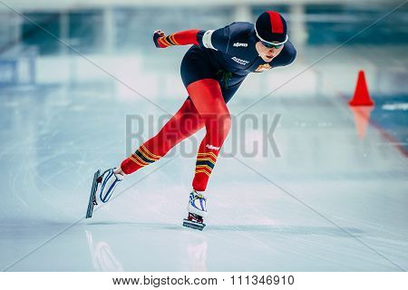closeup young woman athlete speedskater goes around turn sprint distance
