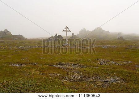 Wooden cross in the fog.