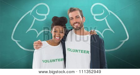 Portrait of two young volunteers with arms around against green chalkboard
