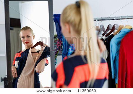 Reflection Of Beautiful Blonde Woman