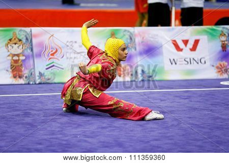 JAKARTA, INDONESIA - NOVEMBER 17, 2015: Zahra Kiani of Iran performs the movements in the women's Compulsory Changquan event at the 13th World Wushu Championship 2015 at the Istora Senayan Stadium.