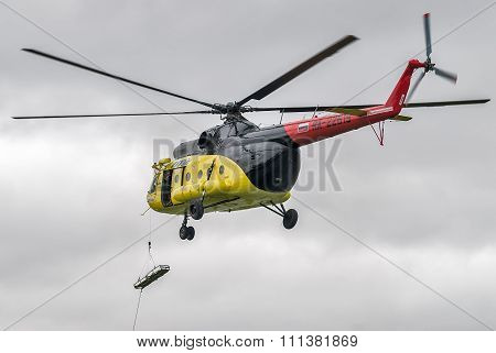 Descent of empty stretcher from MI-8 helicopter