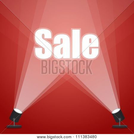word sale. floodlighting. spotlight on a red background