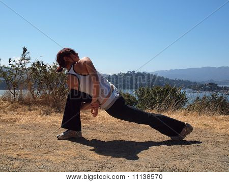 Attractive 20-something Lady Does Bound Side Angle Yoga Pose