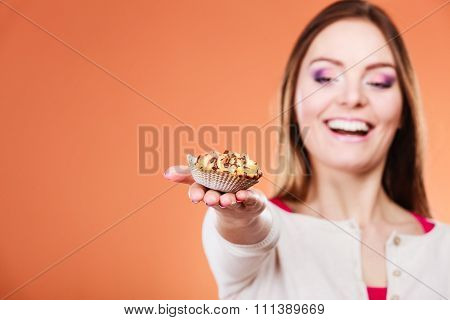 Woman Holding Delicious Sweet Cupcake. Gluttony.