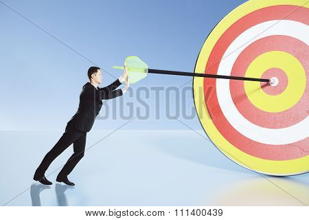 Businessman Making Efforts To Achieve The Goal Concept