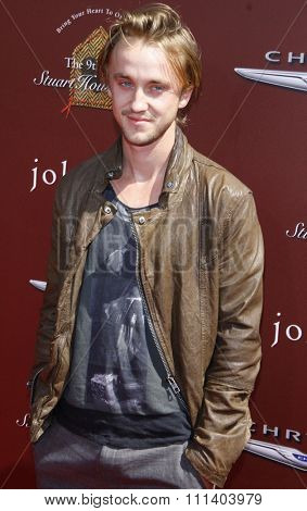 WEST HOLLYWOOD, CALIFORNIA - Sunday March 11, 2012. Tom Felton at the John Varvatos 9th Annual Stuart House Benefit held at the John Varvatos Boutique, Los Angeles.