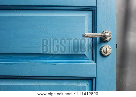Open Wooden Door Painted In Blue Color