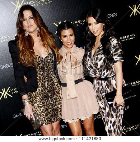 LOS ANGELES, USA - AUGUST 17: Khloe Kardashian, Kourtney Kardashian and Kim Kardashian at the Kardashian Kollection Launch Party held at the Colony in Hollywood, USA on August 17, 2011.