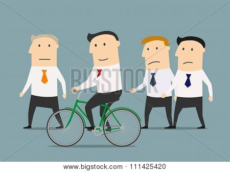 Businessman on bicycle overtaking a colleagues