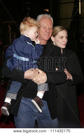 December 1, 2005. Malcolm McDowell, wife Kelley and son Beckett Taylor attend the Wolrd Premiere of Aeon Flux at the Cinerama Dome in Hollywood, California United States.