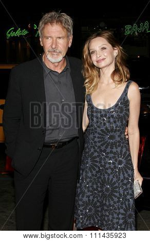 HOLLYWOOD, CALIFORNIA. February 2, 2006. Harrison Ford and Calista Flockhart attend the World Premiere of