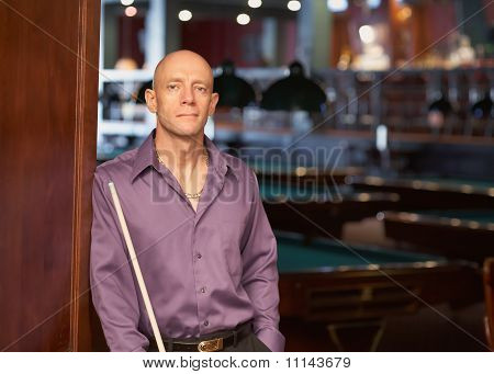 Man with pool stick