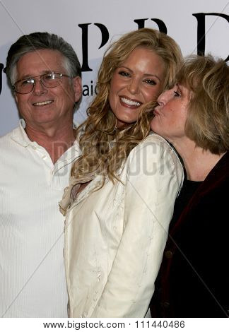 November 17, 2005 - Beverly Hills - Paige Adams-Geller and her parents at the Paige Premium Denim Party at the Paige Premium Denim Flagship Store in Beverly Hills, California United States.