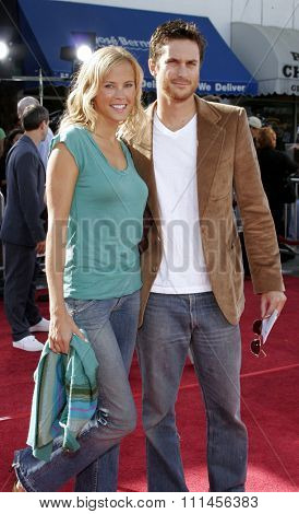 WESTWOOD, CALIFORNIA. October 9, 2005. Erinn Bartlett and Oliver Hudson at the DreamWorks Pictures Premiere of 'Dreamer' at the Mann Village Theatre in Westwood, California United States.