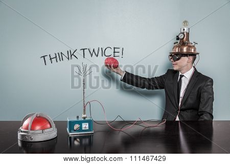 Think twice concept with businessman holding brain