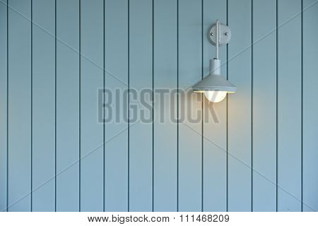 Wooden Wall With White Lamp