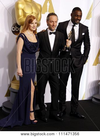 Jessica Chastain, Emmanuel Lubezki and Idris Elba at the 87th Annual Academy Awards Press Room held at the Loews Hollywood Hotel in Hollywood on February 22, 2015.