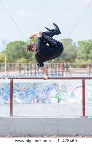 Young Man Jumping On Handrails