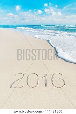 Beach With 2016 Year Caption On Sand. Season Vacation Concept.