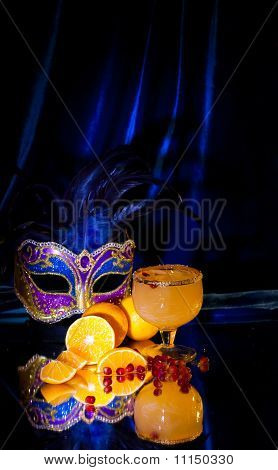 Drink In A Glass, Tangerines, Grains Of A Pomegranate And A Mask
